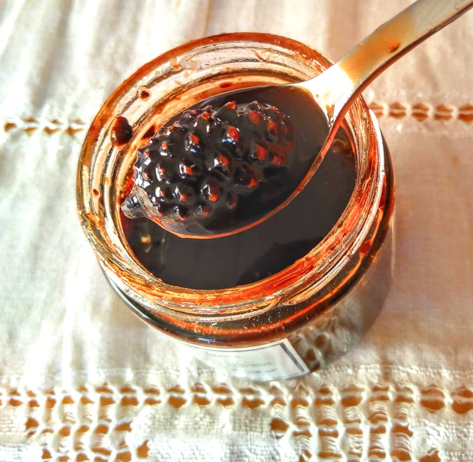 pine cone jam in glass jar with a tea spoon on white lace table cloth photography Tamara jare